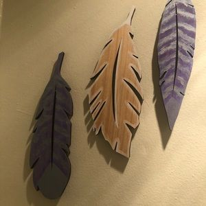 Set of three hand painted wooden feathers